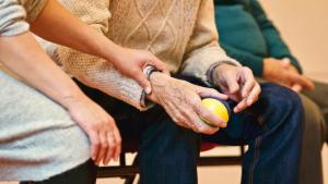 caregiver holding senior's arm
